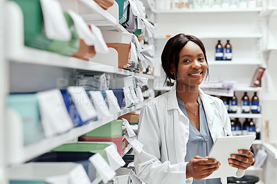 Buy stock photo Cropped portrait of an attractive young female chemist doing stock take while working in the pharmacy
