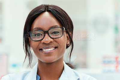 Buy stock photo Cropped portrait of an attractive young female chemist working in the pharmacy