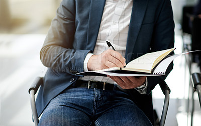 Buy stock photo Closeup shot of a businessman taking notes during a conference
