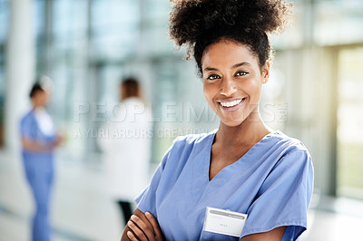 Buy stock photo Portrait of a young nurse standing in a hospital