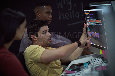 Buy stock photo Shot of a group of young businesspeople working on a computer network during a late night at work