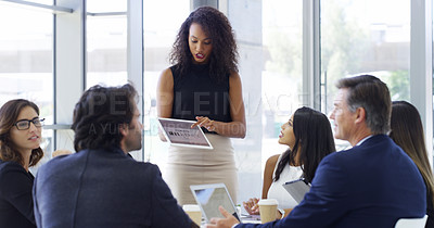 Buy stock photo Cropped shot of a businesswoman shaking hands with colleagues before giving a presentation in an office