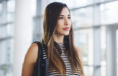 Buy stock photo Cropped shot of a confident young businesswoman walking through a modern office