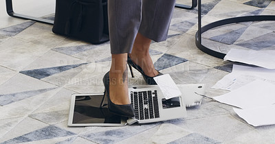 Buy stock photo Cropped shot of an unrecognizable businesswoman breaking a laptop by jumping on it in an office