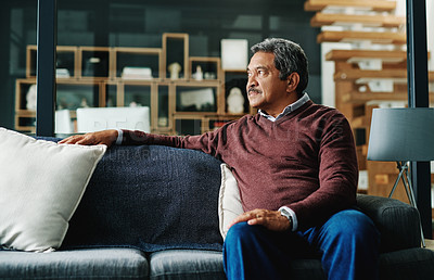 Buy stock photo Cropped shot of a mature man relaxing on the sofa at home