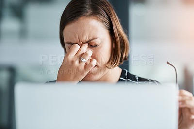 Buy stock photo Cropped shot of a young businesswoman looking stressed while working in an office