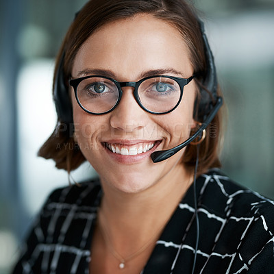 Buy stock photo Cropped portrait of a happy young call centre agent working in an office