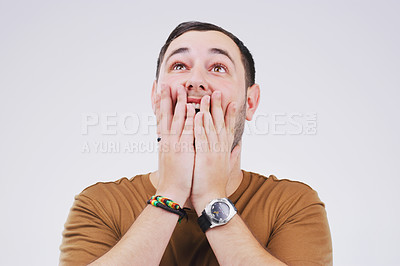 Buy stock photo Studio shot of a handsome young man looking surprised against a grey background