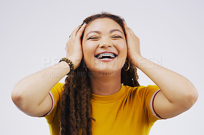 Buy stock photo Studio shot of an attractive young woman looking surprised against a grey background