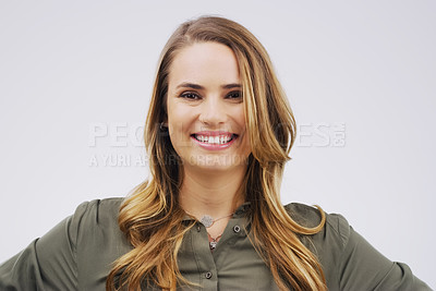 Buy stock photo Studio shot of a happy young woman posing against a gray background
