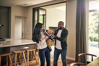 Buy stock photo Shot of an adorable little boy spending quality time with his parents at home