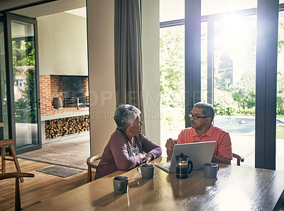 Buy stock photo Shot of a mature couple using a laptop together at home