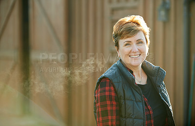 Buy stock photo Portrait of a confident mature woman working on a farm