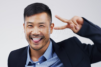 Buy stock photo Studio shot of a handsome businessman feeling cheerful and dancing against a grey background
