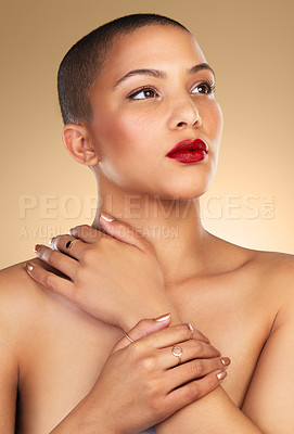 Buy stock photo Studio shot of a beautiful young woman posing against a brown background