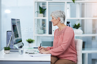 Buy stock photo Shot of a mature woman working on a computer in her office at work