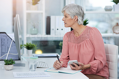 Buy stock photo Shot of a mature woman working in her office