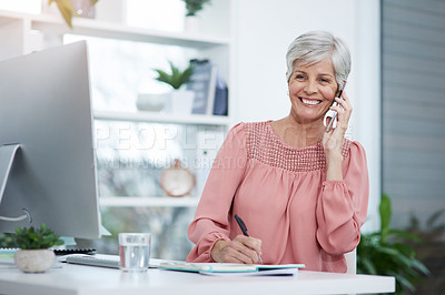 Buy stock photo Shot of mature businesswoman taking a phone call at her office desk at work