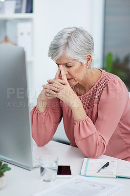 Buy stock photo Shot of a mature businesswoman suffering from a headache in her office at work