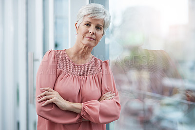 Buy stock photo Portrait of a mature businesswoman posing with her arms folded in her office  at work