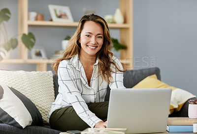 Buy stock photo Portrait of an attractive businesswoman working on her laptop at home