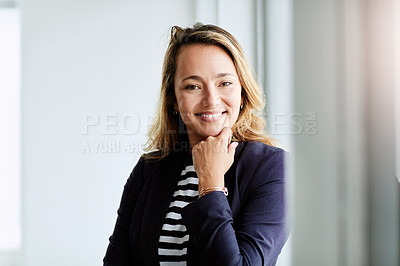 Buy stock photo Portrait of an attractive businesswoman posing with her hand on her chin at work
