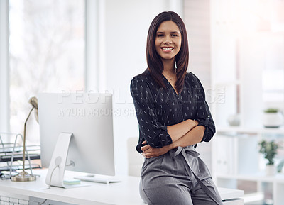 Buy stock photo Portrait of an attractive young businesswoman posing with her arms folded in her office at work