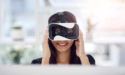 Buy stock photo Shot of a young businesswoman wearing a VR headset while working in her office