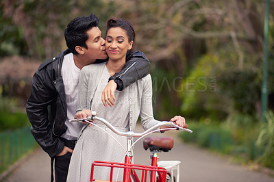 Buy stock photo Shot of a beautiful young couple a stroll together through the park