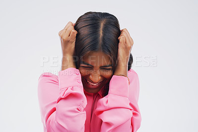 Buy stock photo Studio shot of an attractive young woman looking stressed out against a grey background