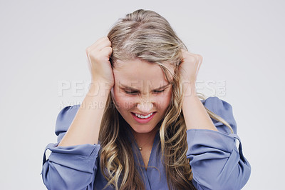 Buy stock photo 4k video footage of an attractive young woman looking stressed out against a grey background