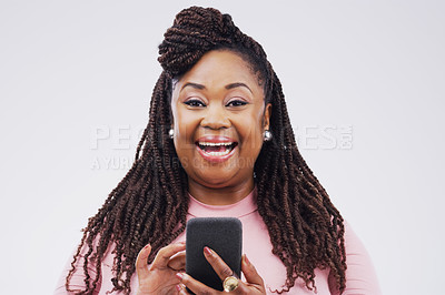 Buy stock photo Studio shot of a happy young woman using her cellphone