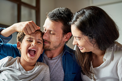 Buy stock photo Shot of a beautiful young couple playing their son at home