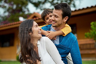 Buy stock photo Shot of a beautiful young family spending some time together outdoors