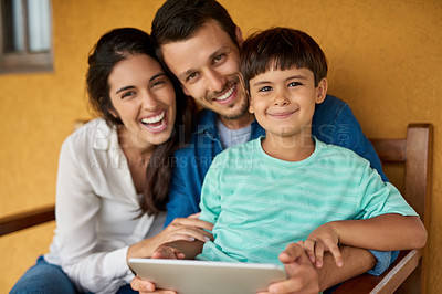 Buy stock photo Portrait of a beautiful young couple and their son using a digital tablet together at home