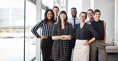 Buy stock photo Shot of a group of well-dressed businesspeople standing together