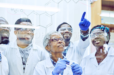 Buy stock photo Shot of a group of scientists drawing molecular structures on a glass wall in an office