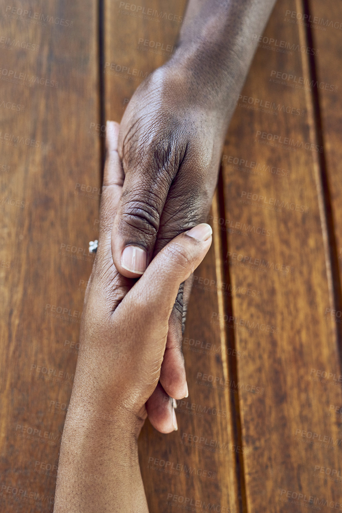 Buy stock photo Closeup shot of a couple holding hands
