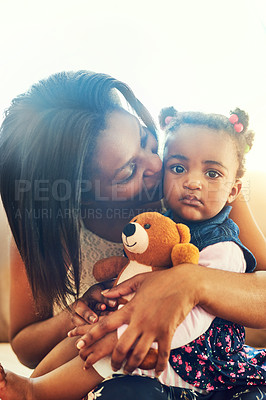 Buy stock photo Shot of a mother bonding with her little daughter daughter at home