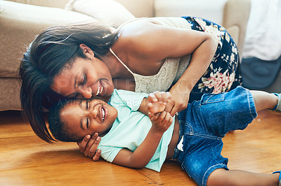 Buy stock photo Shot of a mother playing with her little son at home