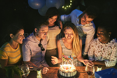 Buy stock photo Shot of friends having a get together outdoors