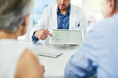 Buy stock photo Cropped shot of an unrecognizable doctor showing test results to a patient inside of his office during the day