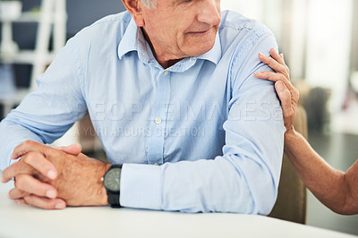 Buy stock photo Cropped shot of an elderly unrecognizable couple looking concerned and talking to each other inside of a doctor's office during the day