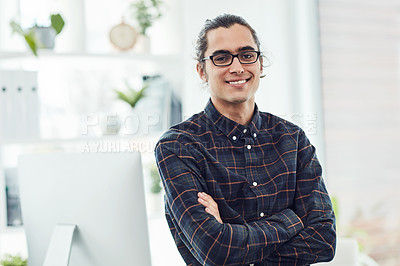 Buy stock photo Portrait of a confident young designer standing in an office