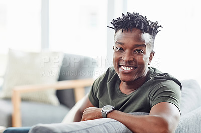 Buy stock photo Portrait of a young man relaxing at home