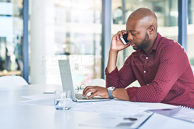 Buy stock photo Cropped shot of a young businessman talking on his cellphone while sitting with his laptop