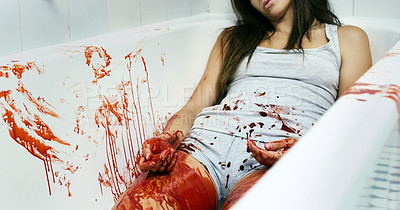 Buy stock photo Cropped shot of an unrecognizable dead body lying in a pool of blood in a bathtub