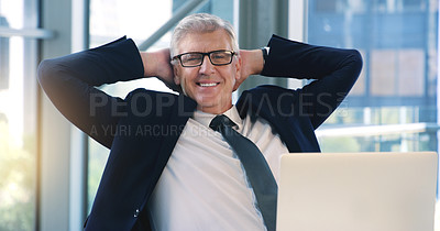 Buy stock photo Portrait of a mature businessman taking a break while working in an office