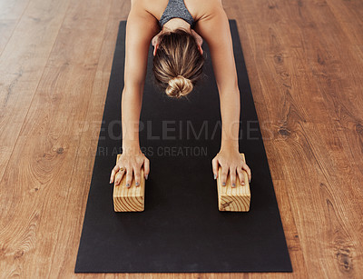 Buy stock photo Shot of a group of unrecognizable young people doing yoga poses during a session inside of a studio