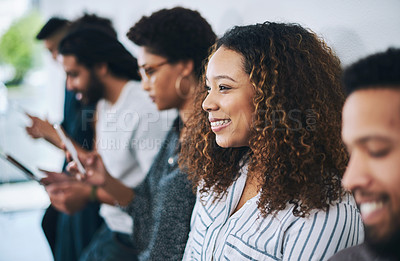 Buy stock photo Shot of a confident young businesswoman waiting in line